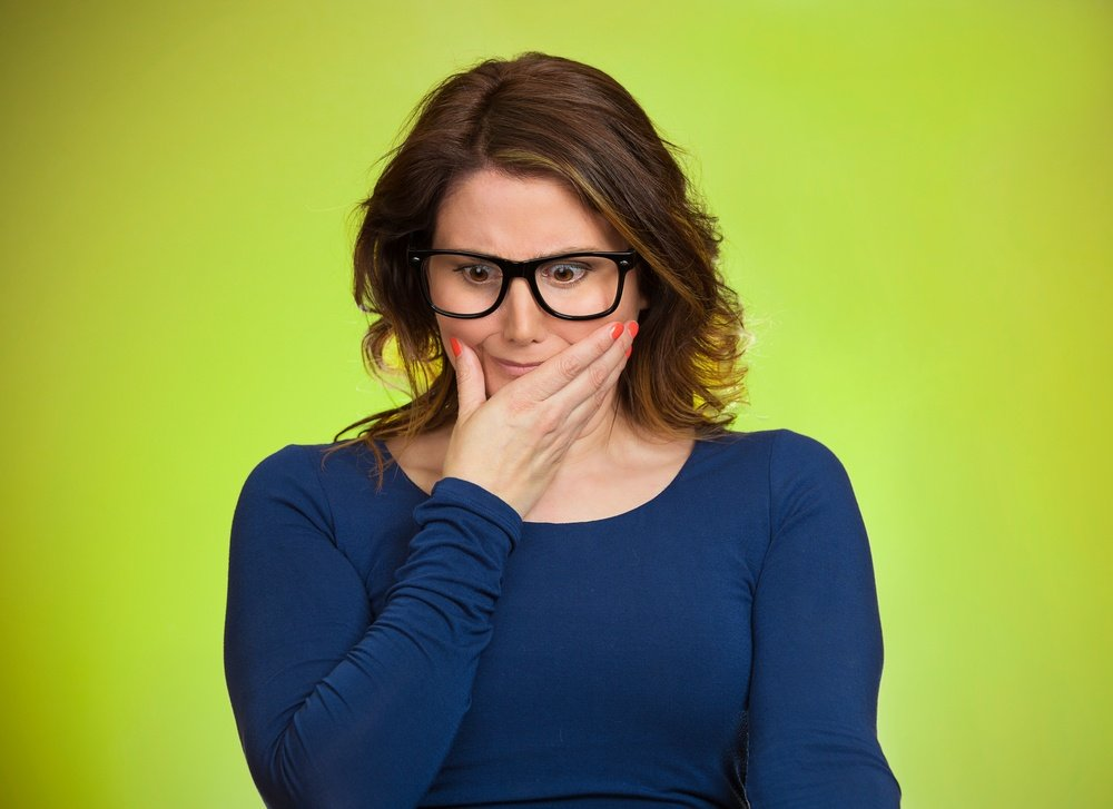 Awkward situation. Portrait embarrassed woman anxiously thinking how to get out of this, isolated green background. Human face expressions, emotions, feelings, reaction, life perception.jpeg