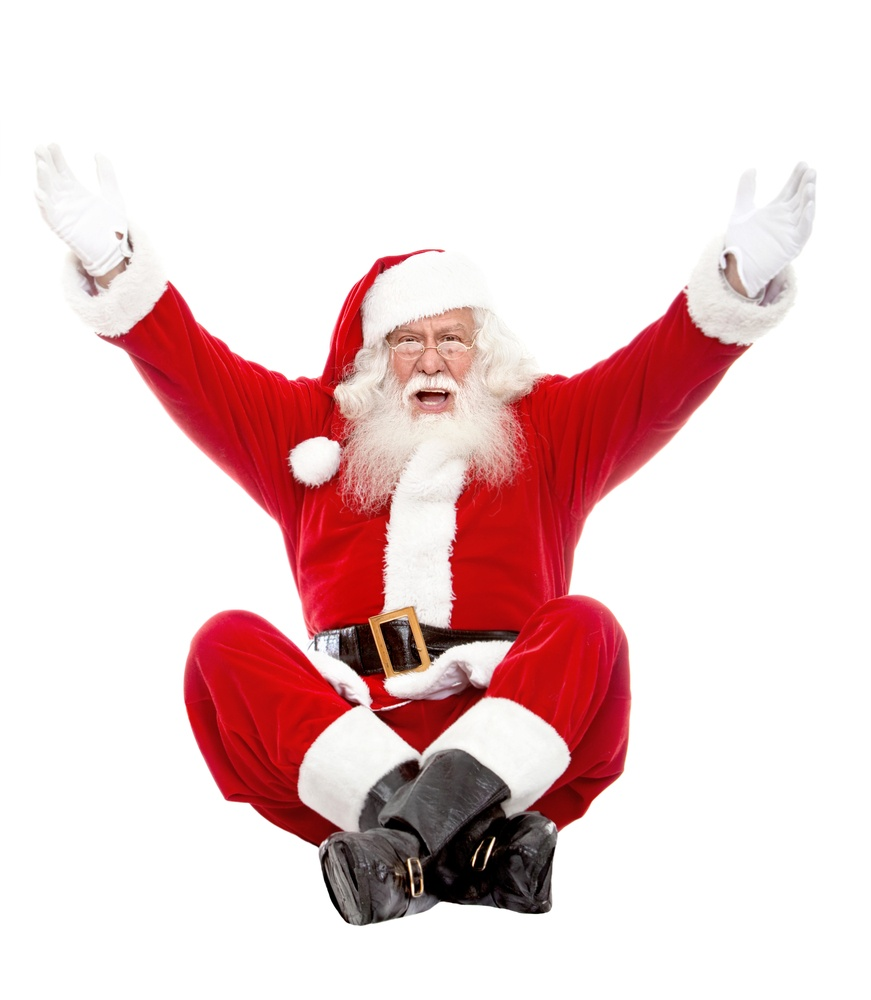 Excited Santa Claus with arms outstretched isolated over a white background.jpeg