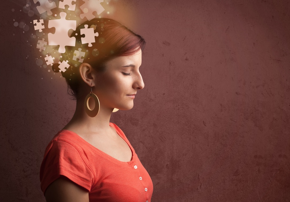 Young person thinking with glowing puzzle mind on grungy background.jpeg