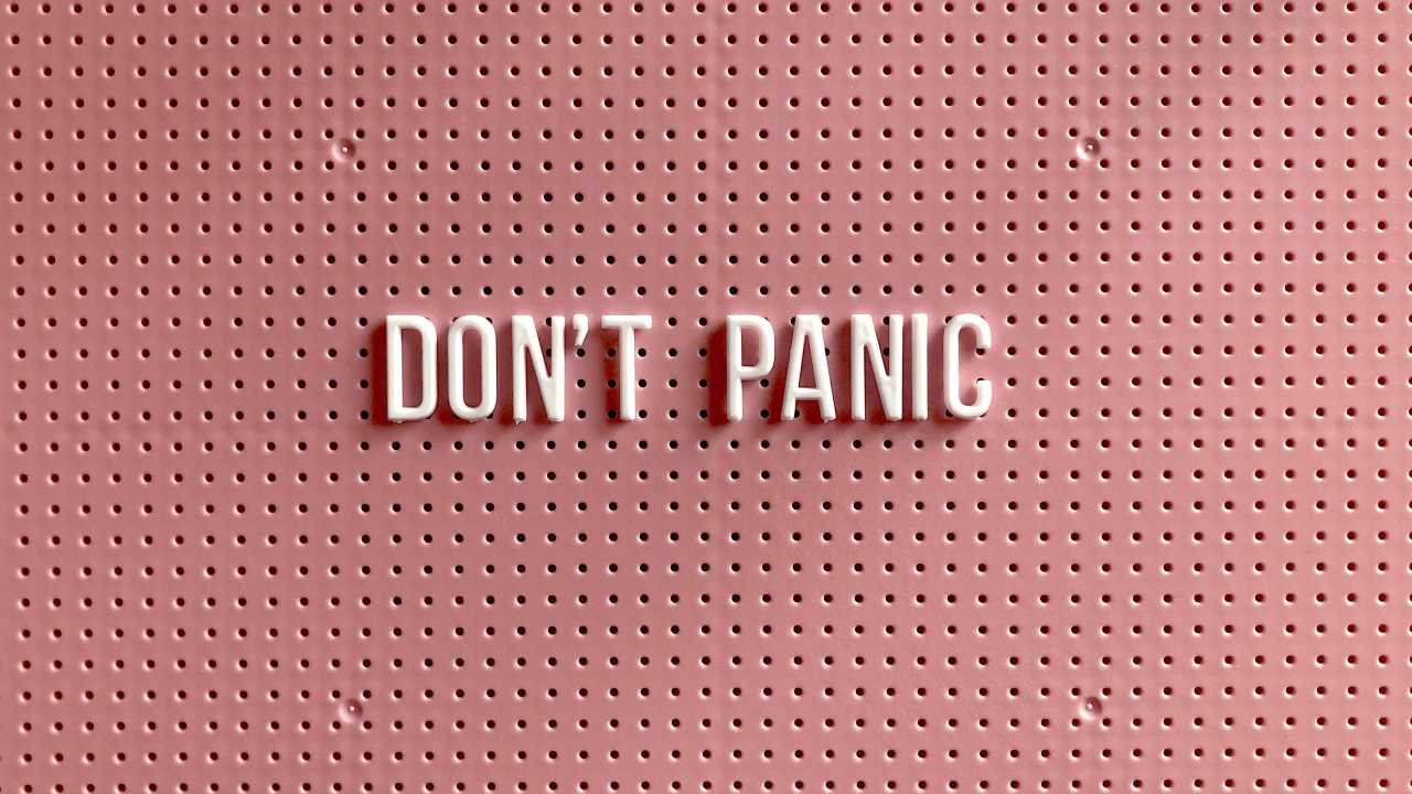 Image of letter board with words Don't Panic